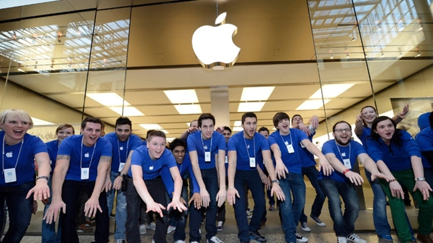 March 16, 2012: Apple employees welcomes hundreds of customers in front of the Apple store at a shopping mall in Oberhausen, western Germany, as the new iPad goes on sale at the Apple store.