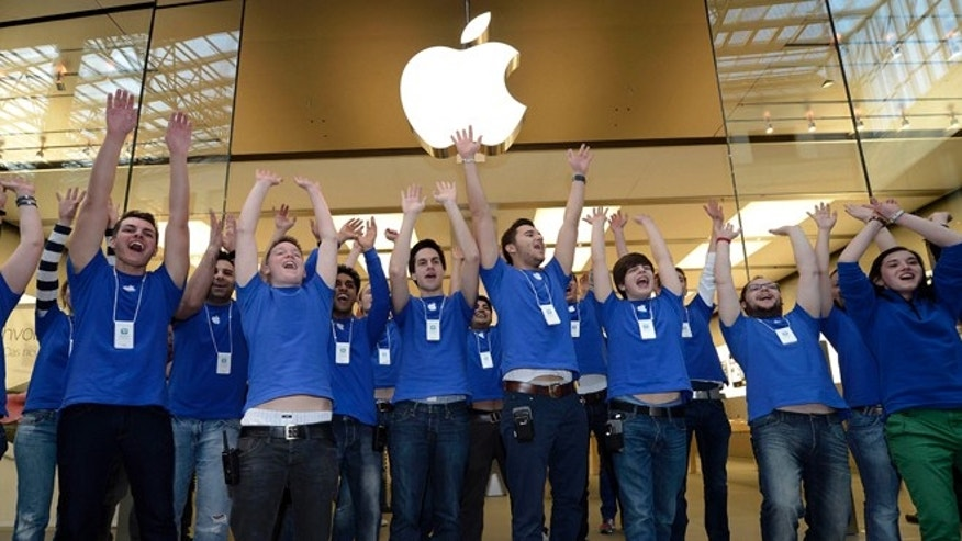 March 16, 2012: Apple employees welcomes hundreds of customers in front of the Apple store at a shopping mall in Oberhausen, western Germany, as the new iPad goes on sale.