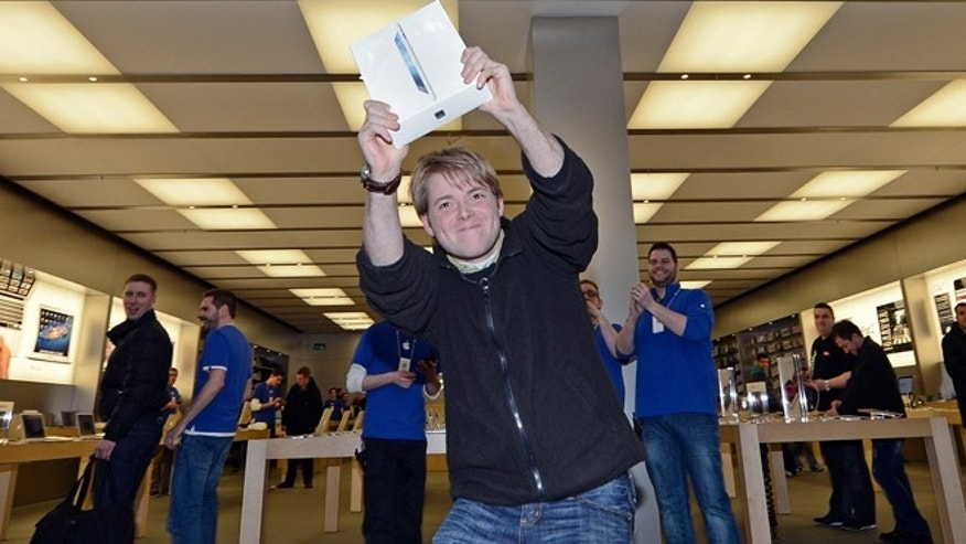 March 16, 2012: Lukas from Germany is the first to get the new iPad at the Apple store in a shopping mall in Oberhausen, western Germany. Apart from a few countries, there is an internationally coordinated simultaneous release of the iPad.