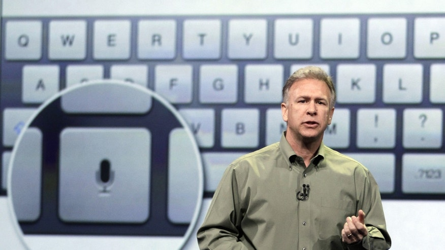 March 7, 2012: Apple's senior vice president of Worldwide Marketing Phil Schiller discuss features of the new iPad during an event in San Francisco.