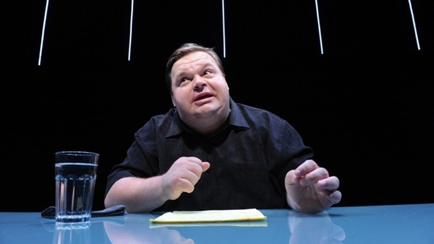 "Mike Daisey is shown in a scene from ""The Agony and The Ecstasy of Steve Jobs,"" in New York. Daisey, whose latest show has been being credited with sparking probes into how Apple's high-tech devices are made, is finding himself under fire for distorting the truth. The public radio show This American Life retracted a story Friday, March 16, 2012, that it broadcast in January about what Daisey said he saw while visiting a factory in China where iPads and iPhones are made."