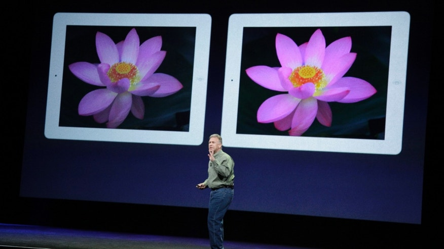 March 7, 2012: Apple's senior vice president of Worldwide Marketing Phil Schiller stands in front of an old iPad, left, and new iPad, right, during an Apple event in San Francisco.