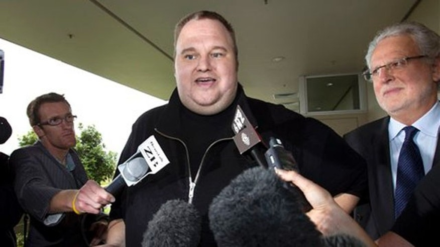 Feb. 22, 2012: In this file photo, Kim Dotcom, the founder of the file-sharing website Megaupload, comments after he was granted bail and released in Auckland, New Zealand.