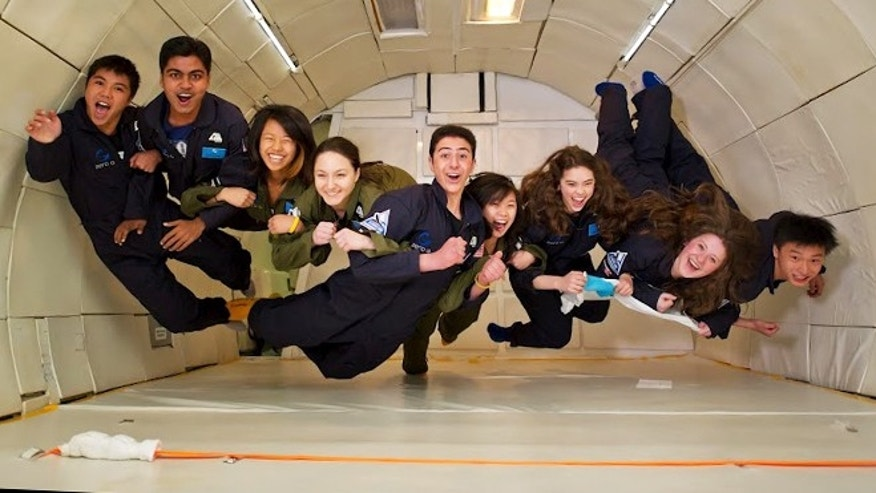 March 22, 2012: 18-year-old Amr Mohamed from Egypt (center), 16-year-olds Dorothy Chen (left) and Sara Ma (to right of Mohamed) from the U.S., and other regional winners of the YouTube Space Lab contest simulate microgravity in Washington, D.C., after an awards ceremony.