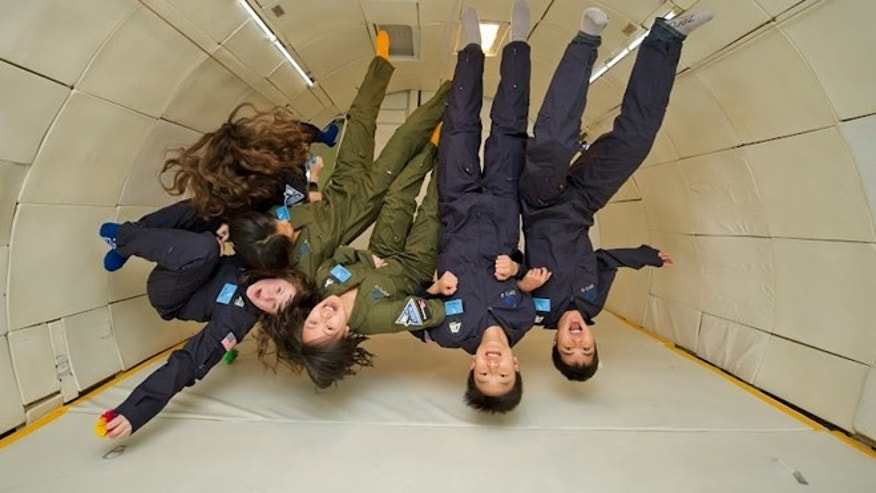 March 22, 2012: Winners of the YouTube Space Lab contest simulate microgravity.