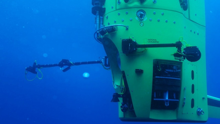 Crews conduct in-water testing in Australia of DEEPSEA CHALLENGER, the submersible that explorer and filmmaker James Cameron piloted to the bottom of the Mariana Trench.