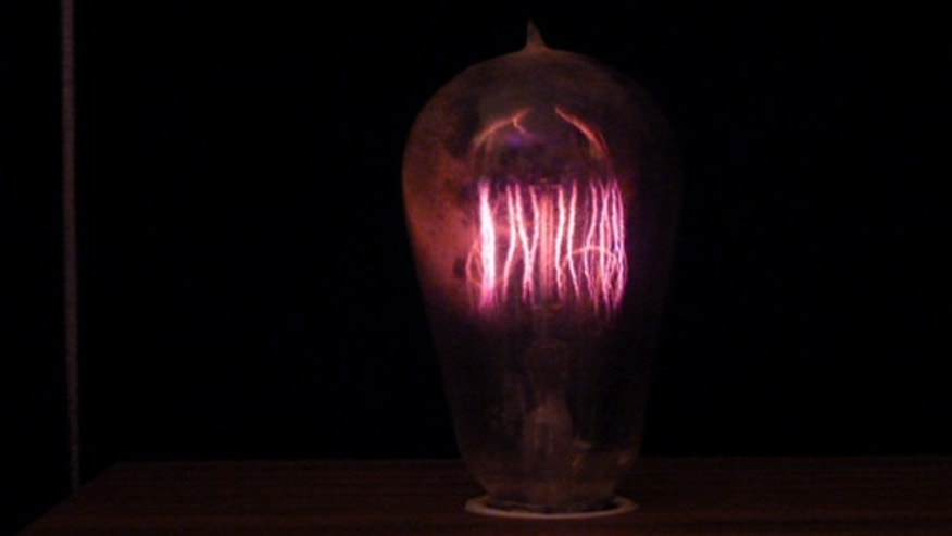 A 100 year old GE bulb lights up.