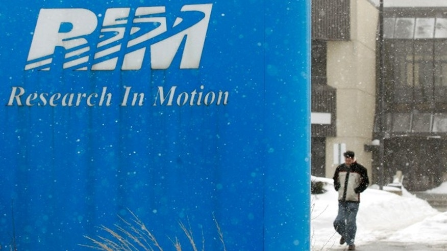 March 5, 2007: A Research In Motion employee leaves the company headquarters in Waterloo. The Struggling BlackBerry maker plans to return its focus to its corporate customers after failing to compete with flashier, consumer-oriented phones.