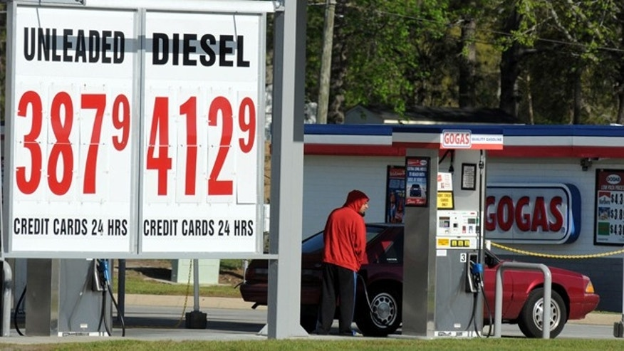 March 27, 2012: Robert Ward of Leland, N.C. pumps gas at GOGAS in Leland.