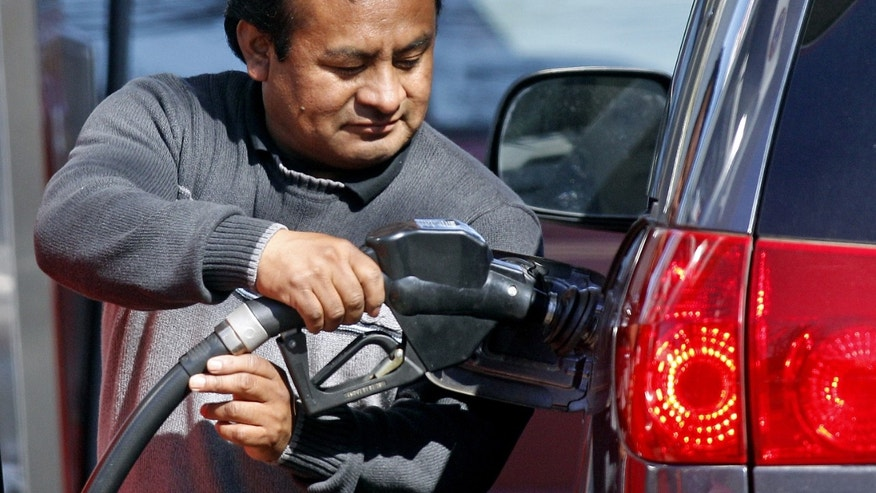March 23, 2012: An attendant pumps gas in Portland, Ore., where oil prices briefly spiked to the highest level in three weeks following a report that Iranian oil exports dropped significantly this month.