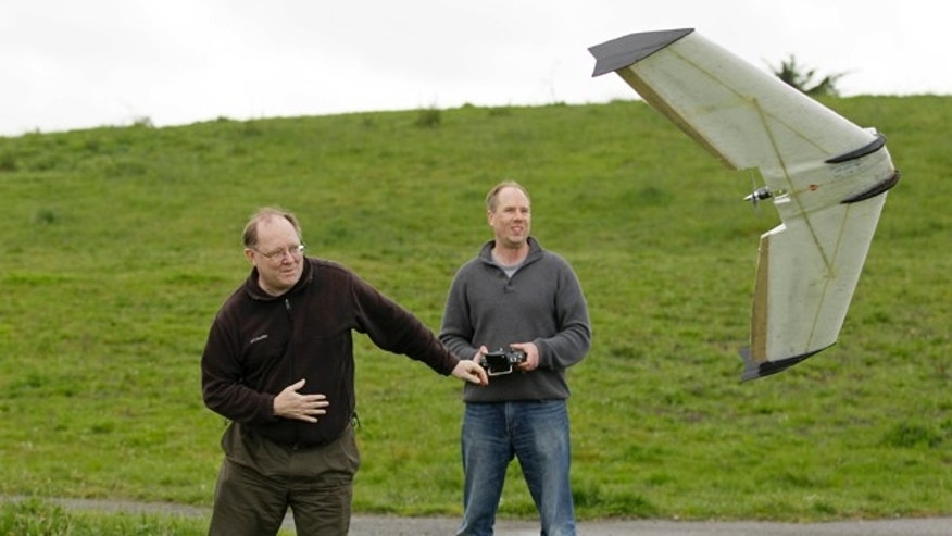 March, 28, 2012: Mark Harrison, left, and Andreas Oesterer, right, watch as a Ritewing Zephyr II drone lifts off at a waterfront park in Berkeley, Calif.