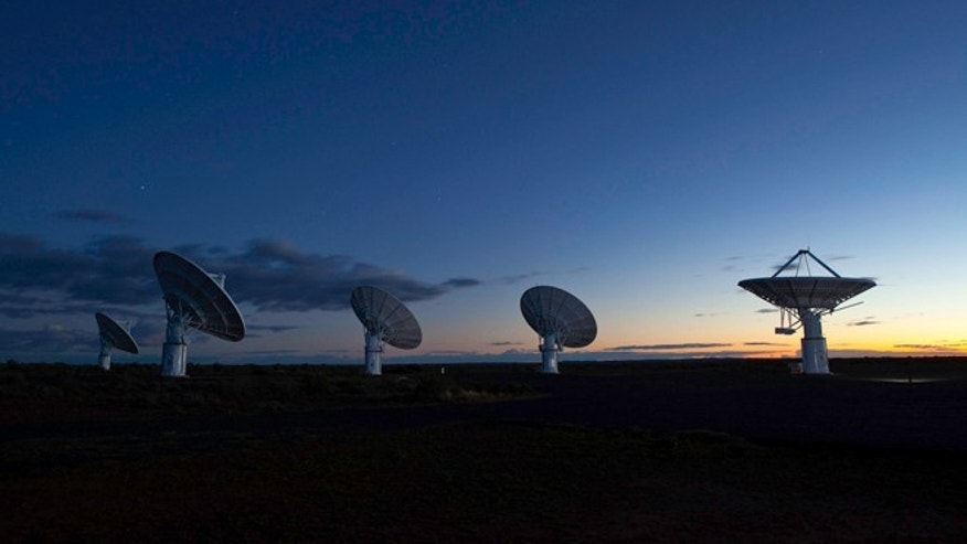 "Radio dishes that make up one part of South Africas KAT-7 array, a prototype for its 64-dish ""MeerKAT"" telescope, a precursor to the full SKA."