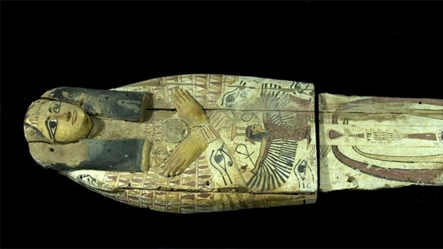 The wooden cover, which would have held a mummy in the past, had been cut in half, likely by smugglers who needed to fit the artifacts into a suitcase.