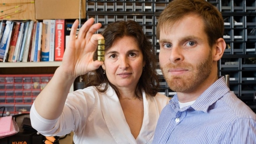 Daniela Rus, left, and Kyle Gilpin, photographed in their office and lab at CSAIL at MIT in Cambridge, Mass.