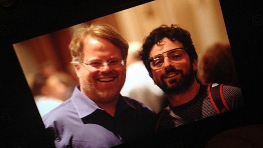 Apr. 5, 2012: Tech analyst Robert Scoble (l) and Google co-founder Sergey Brin (r) attend a charity event in San Francisco, where Brin sported an early prototype of the company's futuristic, augmented reality glasses.