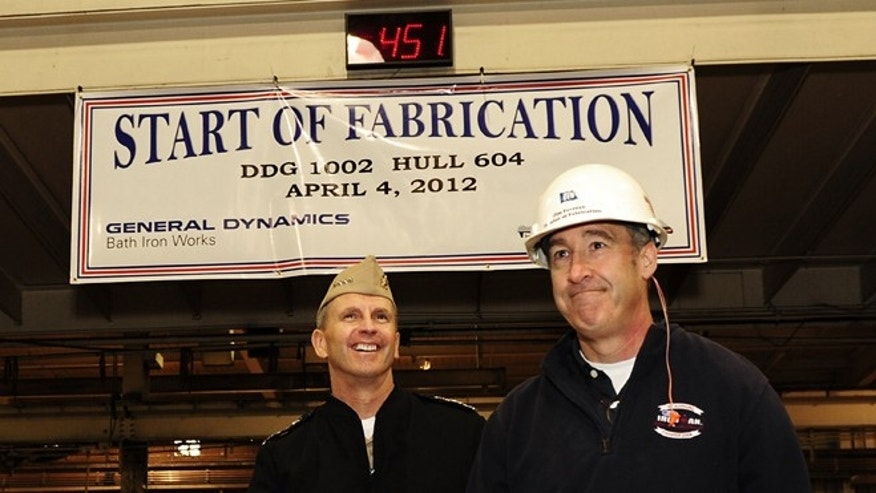 Apr. 4, 2012: Jim Favreau, director of fabrication at Bath Iron works, leading Chief of Naval Operations (CNO) Adm. Jonathan Greenert during a tour of the shipbuilding facility as Greenert makes his way to the start of fabrication opening ceremony for the Zumwalt-class destroyer.