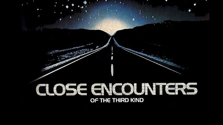"The movie poster for the 1977 Steven Spielberg film, ""Close Encounters of the Third Kind."""
