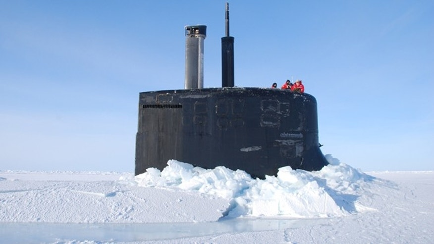 Mar. 19, 2011: Crew members look out from the USS Connecticut, a Sea Wolf-class nuclear submarine, after it surfaced through ice in the Arctic Ocean. The U.S. and other countries are building up their military presence in the Arctic to help exploit its riches - and protect shifting borders.