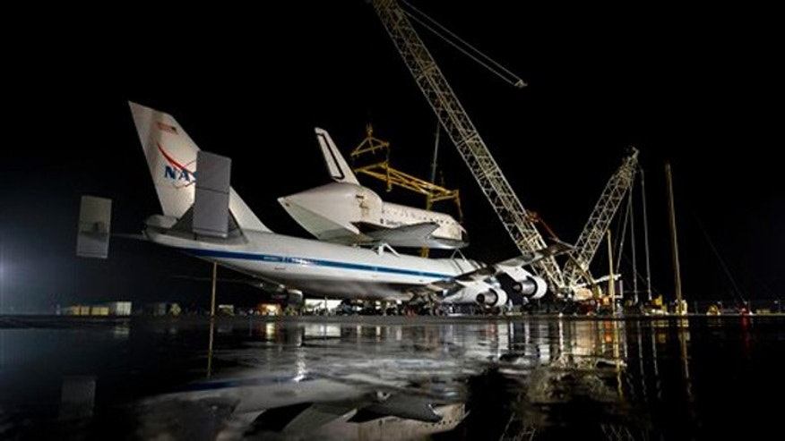 April 17, 2012: In this image provided by NASA the NASA 747 Shuttle Carrier Aircraft with the space shuttle Discovery mated on top rolls into position for demating at Washington Dulles International Airport in Sterling, VA.