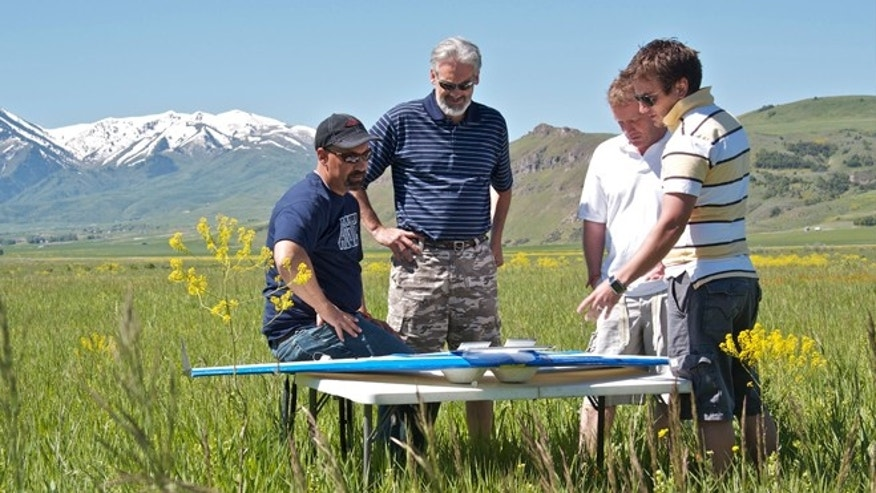 A new fleet of low-cost Styrofoam drones is among a growing group of UAVs intended for American skies. Austin Jensen (far right), lead pilot and research engineer with the Utah Water Research Laboratory, makes a final check with team members prior to launch.