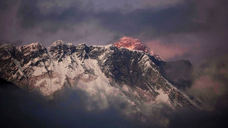 Oct. 27, 2011: The last light of the day sets on Mount Everest as it rises behind Mount Nuptse as seen from Tengboche, in the Himalaya's Khumbu region, Nepal. A team of American scientists and researchers is setting up a laboratory at Mount Everest to study the effects of high altitude on humans.