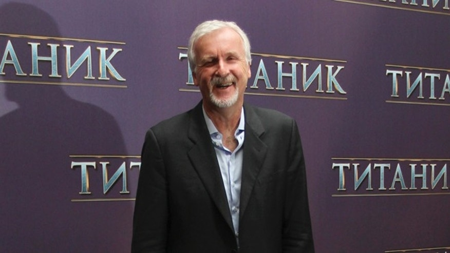 "U.S. film director James Cameron poses for a photograph during a presentation for the media in Moscow March 29, 2012. Cameron is visiting the Russian capital to promote his film ""Titanic 3D"".  REUTERS/Ivan Burnyashev (RUSSIA - Tags: ENTERTAINMENT)"
