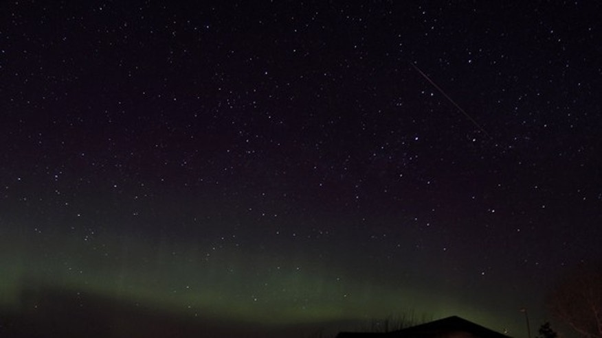 Photographer Bill Allen of Ralph, Saskatchewan in Canada captured this amazing view of a Lyrid meteor and the northern lights during the Lyrid meteor shower peak overnight on April 21-22, 2012.