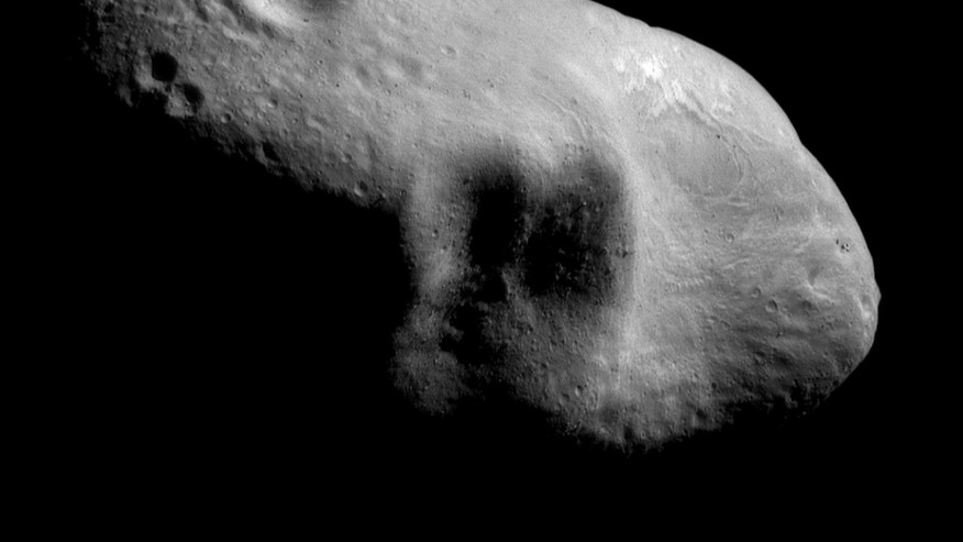 This March 3, 2000 image provided by NASA shows the near-Earth asteroid Eros from the NEAR spacecraft at a distance of 127 miles (204 kilometers).