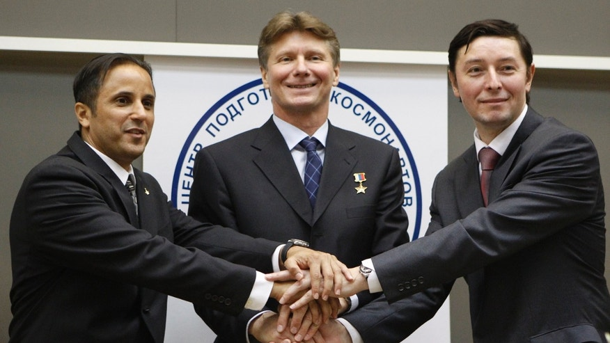 Apr. 25, 2012: Members of the next expedition to the International Space Station, U.S. astronaut Joseph Acaba, left, and Russian cosmonauts Genady Padalka, center, and Sergey Revin, right, shake hands after a news conference at Russian Space Training Center in Star City outside Moscow, Russia.