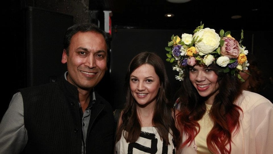 "April 25, 2012:  Poshmark founder and CEO, Manish Chandra with ""Posh"" party hosts at the Poshmark app event in New York City."