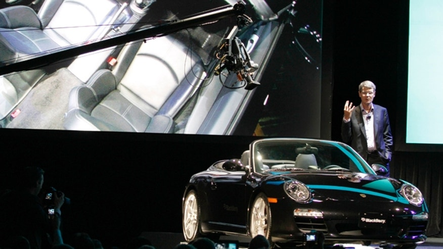May 1, 2012: Thorsten Heins, president and CEO of Research In Motion, introduces a BlackBerry-integrated automobile during the BlackBerry World conference in Orlando Fla.