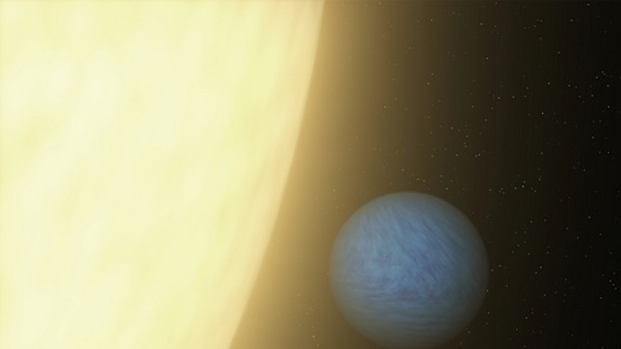 This artist's concept shows the super-Earth planet 55 Cancri e. It's a toasty world 41 light-years from Earth that rushes around its star every 18 hours.