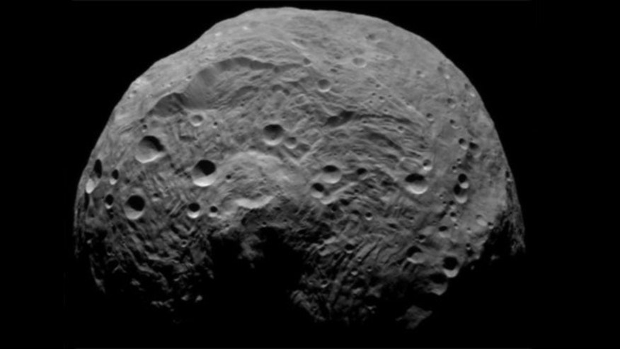 Mammoth asteroid Vesta got one-two crater-carving punch ...