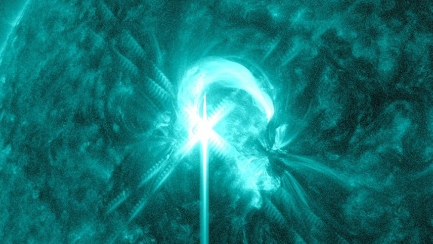 The sun unleashed an M4.7 class flare at 8:32 EDT on May 9, 2012 as captured here by NASA's Solar Dynamics Observatory. The flare was over quickly and there was no coronal mass ejection associated with it. This image is shown in the 131 Angstrom wavelength, a wavelength that is typically colorized in teal and that provided the most detailed picture of this particular flare.