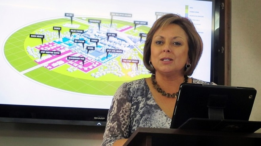 May 8, 2012: New Mexico Gov. Susana Martinez speaks during a news conference in Albuquerque, N.M., where it was announced that Hobbs and Lea County had beat out a second finalist, Las Cruces, for a new $1 billion research center.