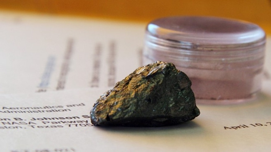 Apr. 23, 2012: A piece of rock that Rafael Navarro, a former Colombian toy manufacturer, contends came from the moon, in Buffalo, Texas. Navarro placed rock fragments in the accompanying small plastic box for sale on eBay and sought $300,000 for them.