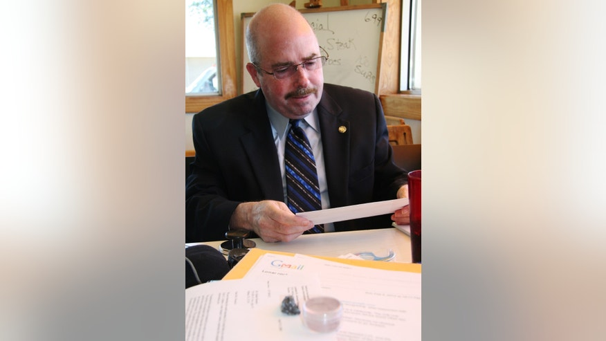 Ap.l 23, 2012: Houston-area attorney Joe Gutheinz reviews documents in Buffalo, Texas, from a Colombian man, Rafael Navarro, who contends he has a moon rock and is offering pieces from it for sale on eBay for $300,000.
