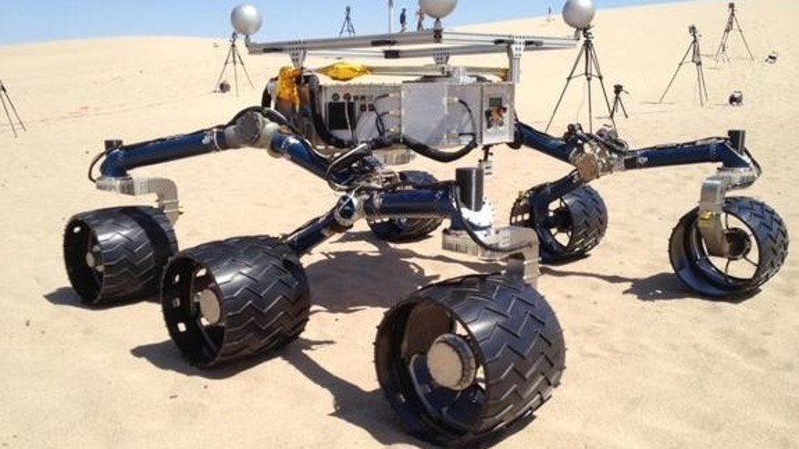 A mockup of NASA's Curiosity Mars rover gets its wheels dirty in sand dunes near California's Death Valley in early May 2012.