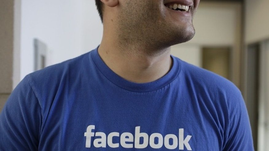 Feb. 8, 2012: A Facebook worker smiles inside Facebook headquarters in Menlo Park, Calif.