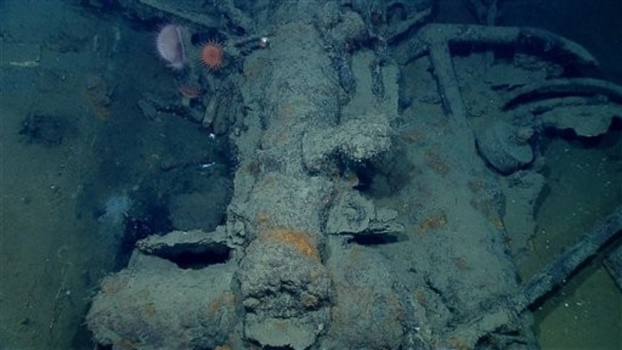In this photo provided by NOAA Okeanos Explorer Program, a well preserved shipwreck is seen about 200 miles off the coast of La., at a depth around 4,000 feet, in the  Gulf of Mexico, Friday, April 26, 2012. A large cast-iron cannon lies next to an anchor.The wheel to the right of the anchor may be part of the gun carriage.  (AP Photo/NOAA Okeanos Explorer Program)