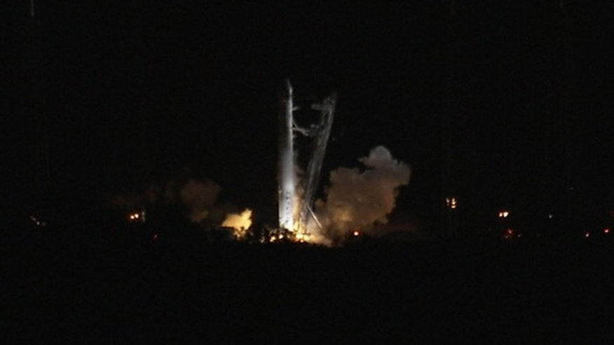 May 19, 2012: SpaceX's first Falcon 9 rocket launching toward the International Space Station ignites its nine main engines briefly in this NASA photo shortly before aborting the launch try due to an unexpected engine sensor reading.