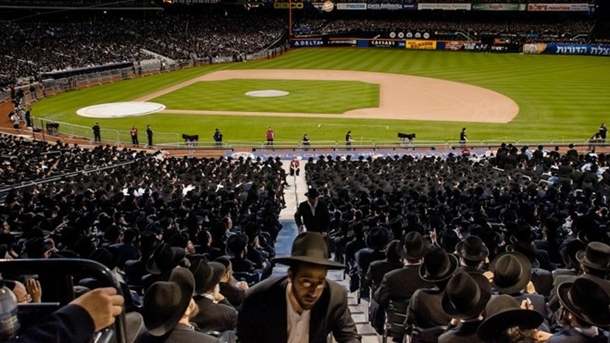 May 20, 2012: Ultra-Orthodox Jews who believe that the Internet threatens their way of life fill New York's Citi Field for an unprecedented gathering on how to use modern technology in a religiously appropriate way.