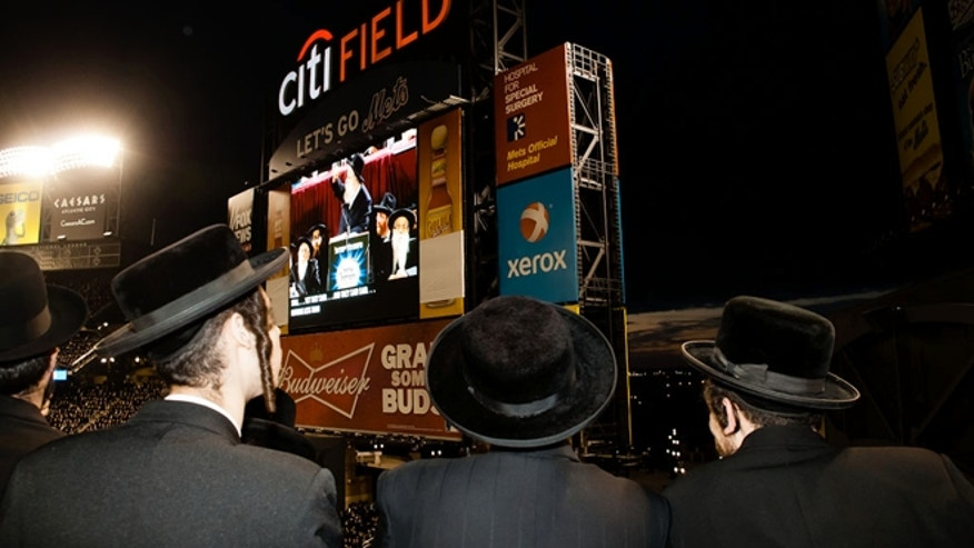 May 20, 2012: Ultra-Orthodox Jews who believe that the Internet threatens their way of life fill New York's Citi Field for an unprecedented gathering on how to use modern technology in a religiously appropriate way in New York.