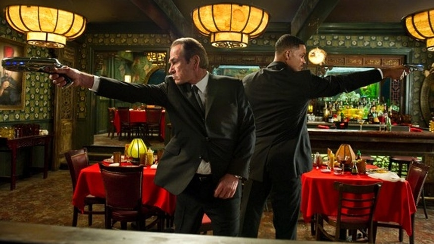 Tommy Lee Jones (left) and Will Smith star in Columbia Pictures' MEN IN BLACK 3.