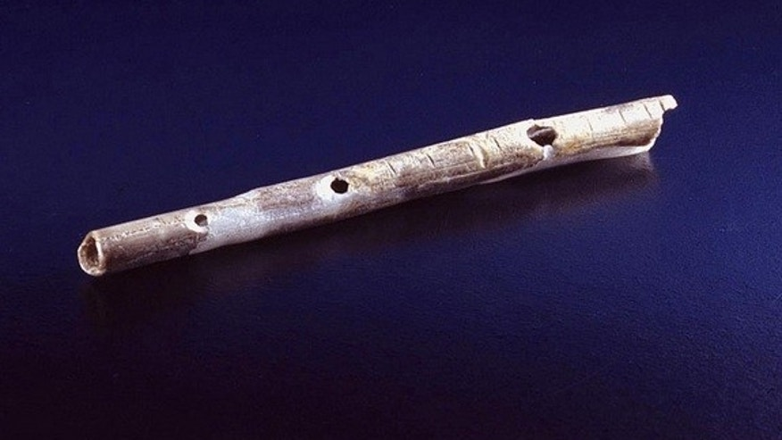 40,000 year old flute from the site of Geißenklösterle made from bird bones.