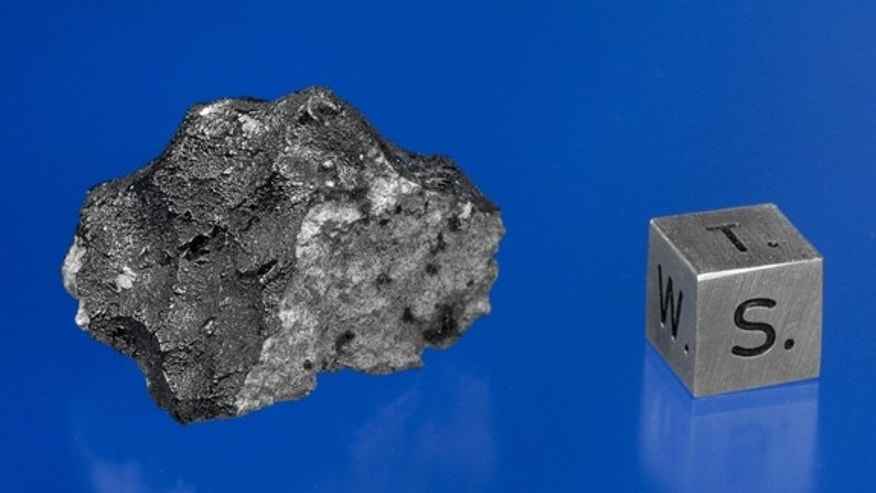 This is an image of a fragement of a Martian meteorite recovered in December 2011 near Tissint Morocco following a meteorite shower which occured on July 18, 2011.  This is part of the first meteorite shower of chunks of the planet Mars to have struck Earth in 100 years.  This specimen is in the Macovich Collection.