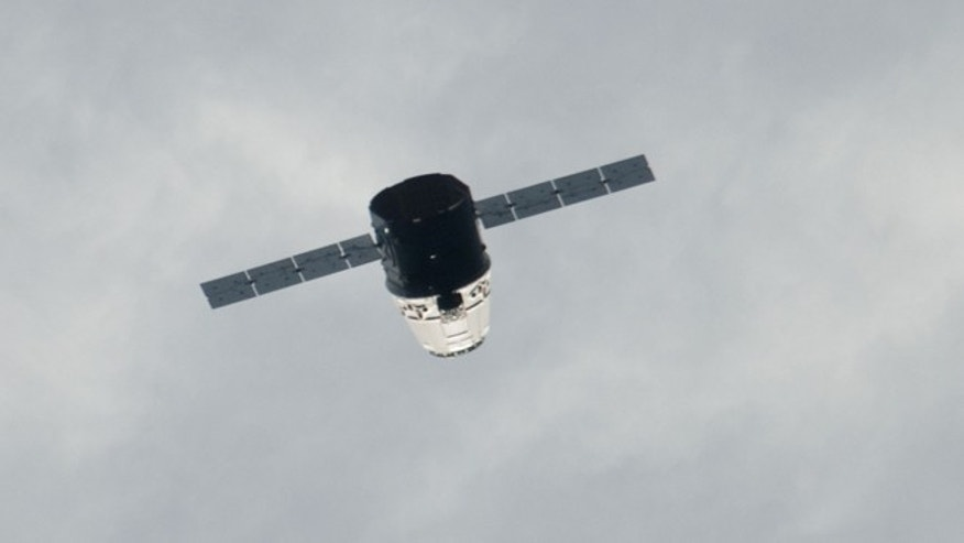 May 24, 2012: The SpaceX Dragon commercial cargo spacecraft approaches the International Space Station prior to docking, scheduled for Friday, May 25, 2012.