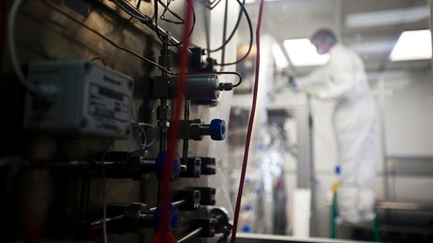 May 29, 2012: A scientist works in an above-ground version of a laboratory to be opened nearly 4,900 feet beneath the earth in Lead, S.D. The lab's experiments will include the world's most sensitive dark-matter detector.