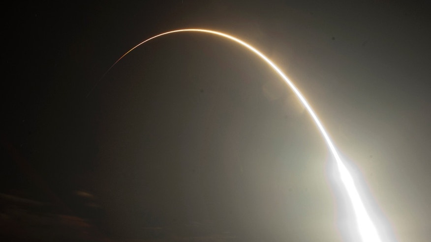 May 22, 2012: The Falcon 9 SpaceX rocket is seen during a time exsposure as it lifts off from space launch complex 40 at the Cape Canaveral Air Force Station in Cape Canaveral, Fla. This launch marks the first time, a private company sends its own rocket to deliver supplies to the International Space Station.