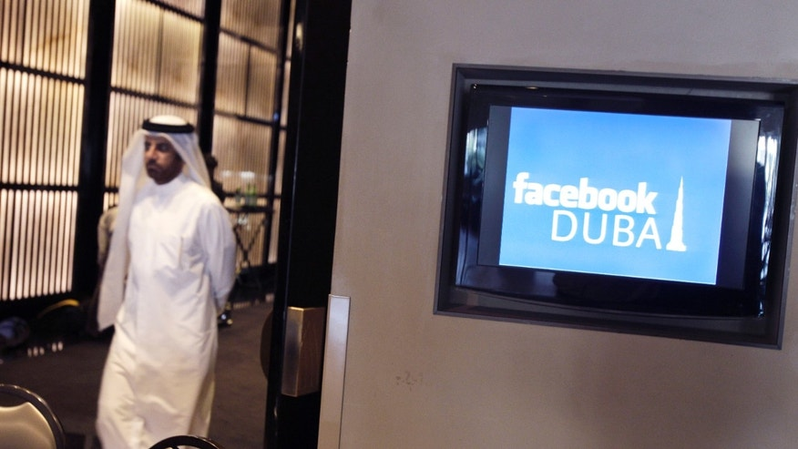 May 30, 2012: An Emirati man leaves the press conference announcing Facebook's opening of its first Middle East and North Africa office at the Armani hotel in Dubai, United Arab Emirates.